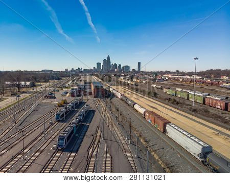 View of a train yard with the city of Charlotte, NC in the background