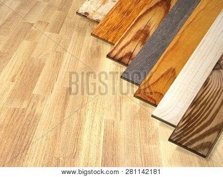 New parquet planks of different colors with different wood species on wooden floor. 3d render