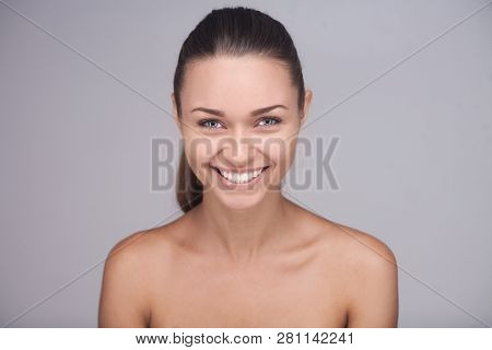 Closeup Studio Poirtrait Of Brunette Woman With Short Fair Hair And Glad Smile. Girl With Broad Smil