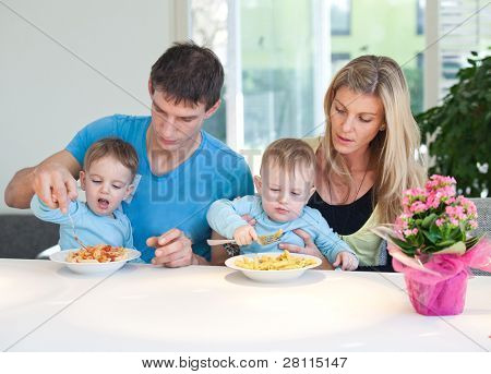 Young family having a hard time feeding baby twins