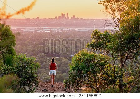 Girl Watches Sunset Over The Perth City Skyline From The Perth Hills (kalamunda Zig Zag). Perth, Wes