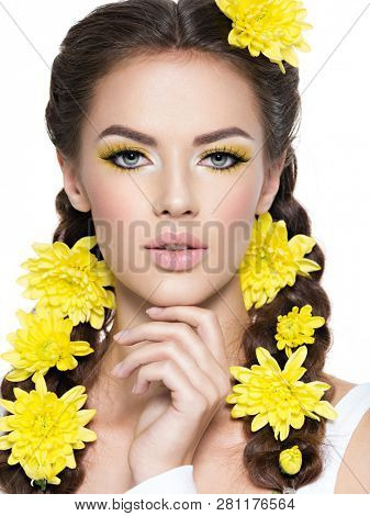 Closeup face of an young beautiful woman with bright yellow make-up. Fashion portrait. Attractive girl with stylish hairstyle, pigtails -   isolated on white. Professional  makeup.  poster
