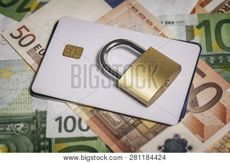 Security Lock On Credit Cards And Euro Banknotes, Close Up. Credit Card Data Encryption For Security