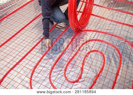 Pipefitter installing system of heating. Heating system and underfloor heating.