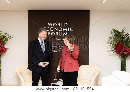 Davos, Switzerland - Jan 26, 2019: President Of Ukraine Petro Poroshenko And Federal Chancellor Of T