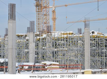 Building Construction Site With Scaffolding Under The Snow