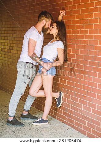 Desire And Temptation. Girl And Hipster Strong Desire Feeling. Couple Find Place To Be Alone. Couple