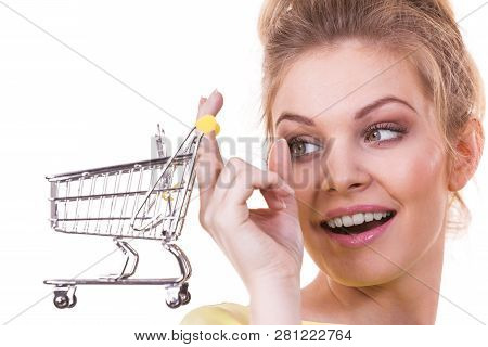 Customer Buying In Shop. Happy Woman Holding Small Tiny Shopping Cart Trolley About To Buy Products.