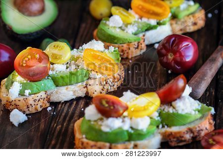 Avocado Toast Sandwich With Avocados, Fresh From The Garden Heirloom Tomatoes And Feta Cheese, Greek
