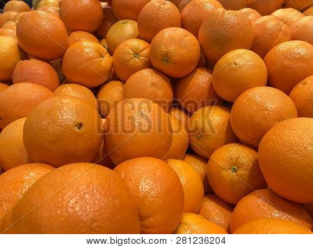 Oranges. Pail of oranges. Orange fruits. Oranges ready for sale. Juice of oranges. Lots of fresh oranges fruits plucked from branch of orange tree.