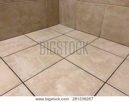 tiles 18 x 18. Floor tiles newly installed. bathroom floor made of tiles. flooring with beige colored tiles.  Porcelain big size floor tiles for bathroom and kitchen floors.