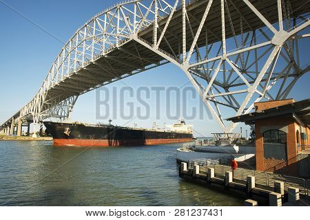 Oil Tanker With A Tug Boat Escort Passing Under The Corpus Christi Harbor Bridge