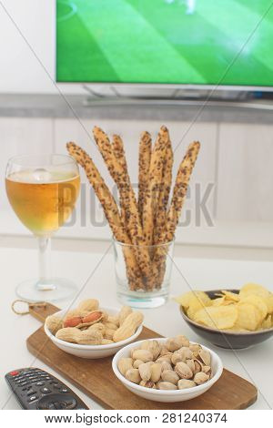 Football Snacks And Football Game On Tv On The Background Supporting National Team Concept Football