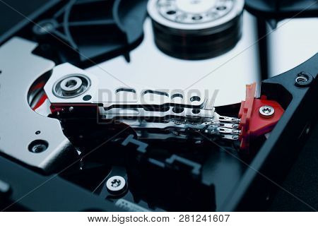 Disassembled Magnetic Device Hard Disk, Hard Drive, Data Storage, Hdd, Read And Write Head With The