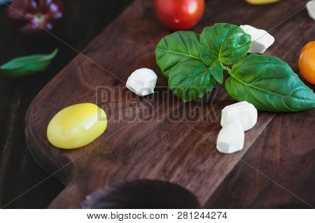 Fresh From The Garden Basil And Heirloom Tomatoes With Mozzarella Cheese For Caprese Salad, Italian