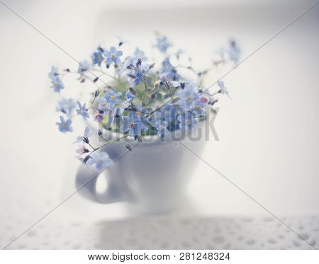 Bouquet Of Blue Forget-me-nots In A White Cup On A Lacy Tray, The Top View.