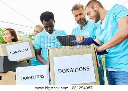 Volunteers in volunteer with donation boxes for a social project