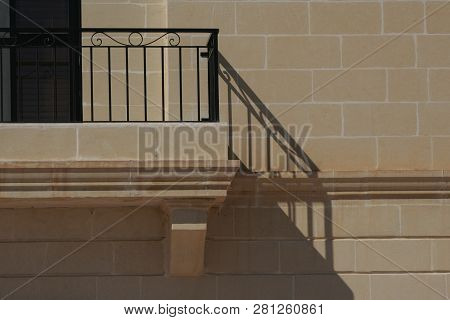 Abstract Detail Of A Frontage With Terrace And Its Shadow