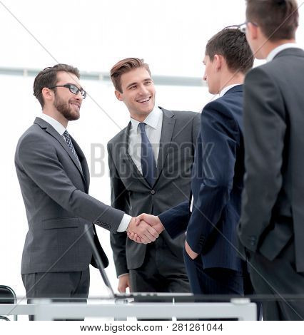 welcome handshake of business partners
