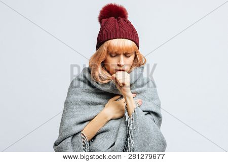 Cute Sick Young Teen Woman In Red Hat, Wrapped In Warm Scarf Coughing, Closed Eyes.female Feeling Th