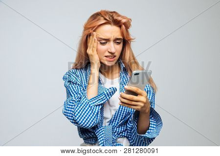 Shocked Surprised Young Cute Woman With Strawberry Blonde Hair Looking At Her Phone, Receives Sms, N