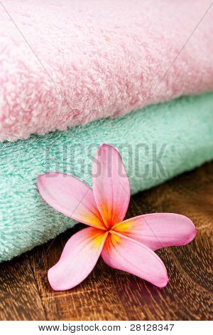 Clean Fresh Towel With Tropical Plumeria For Spa And Wellness Concept Focus Pointed At The Tropical