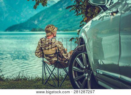 Weekend At The Lake. Caucasian Men Speeding His Free Time On The Lake Shore. Car Getaway.
