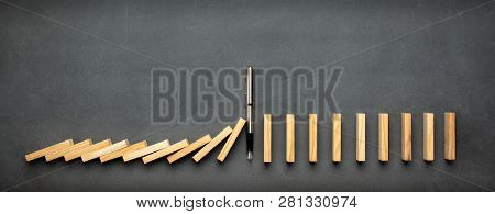 Chain Reaction In Business Concept, Pen Intervening Dominoes Toppling poster