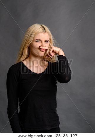 girl gesture smells bad Bad smelling concept. Studio shot of disgusted young European woman pinching her nose because of awful stink coming out from garbage or spoiled food. Negative human emotions poster