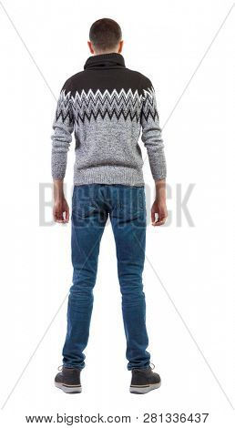 Back view of a stylish man in a knitted sweater. Rear view people collection.  backside view of person.  Isolated over white background. The guy in the winter warm sweater stands with his hands down.