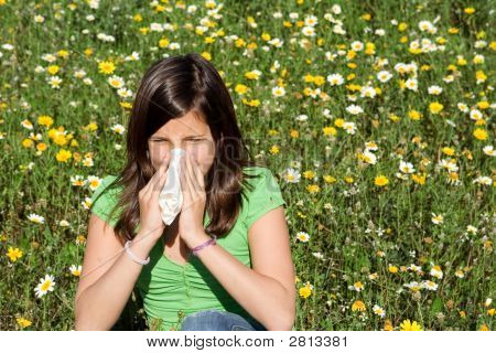 Child With Hayfever Allergy Blowing Nose