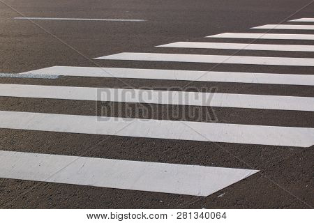 White . Line On City Asphalt Road Background. Pedestrian Crossing. Copy Space For Text.