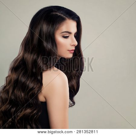 Healthy Hair Woman. Nice Girl With Brown Curly Hair. Hair Care Concept