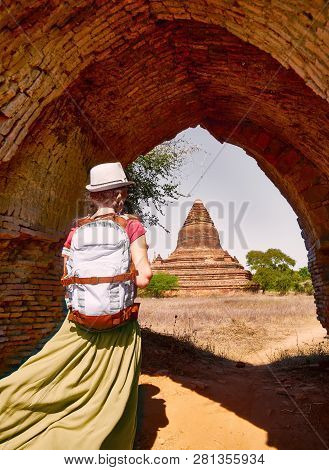 Happy Woman Traveler With A Backpack Walking Through The Old Bagan Looking The Ancient Buddhist Stup
