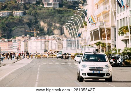 Naples, Italy - October 17, 2018: Fiat 500x Type 334 Taxi Car Moving In Via Partenope Street. Subcom
