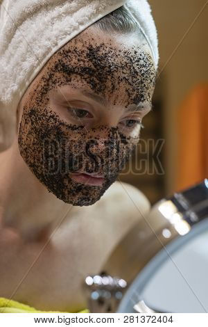 Mask On The Face Of Coffee Scrub. Face Skin Scrub. Face Skincare.