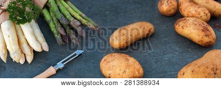 Fresh Asparagus And New Potatoes On A Gray Slate Plate For A Healthy Dinner