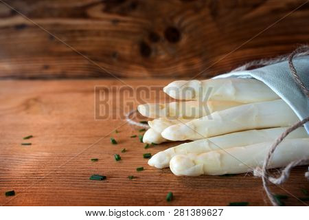 Bunch Of Fresh White Asparagus On Wooden Background