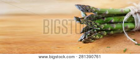 Bunch Of Fresh Green Asparagus On Bright Wooden Table