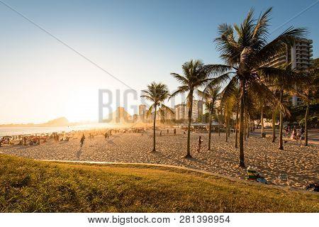 Sunset View Through Palm Trees In Copacabana Beach In Rio De Janeiro, Brazil