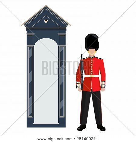 Sentry Of The Grenadier Guards Outside Buckingham Palace. A Soldier In A Red Uniform And Bearskin Ca