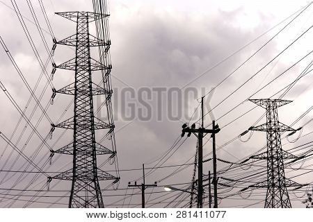 Electricity pole against blue sky clouds in dawn time, Transmission line of electricity to rural, Hi