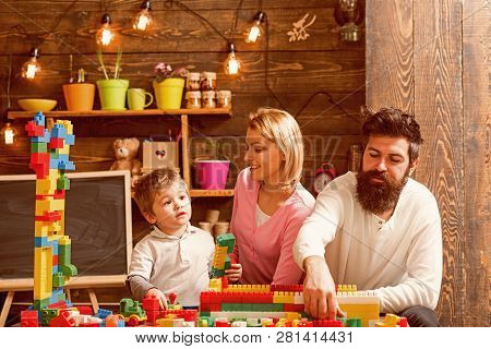 Daycare Concept. Little Child Play Daycare Game With Mother And Father. Daycare Preschool. Family Da