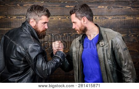 Brutal Bearded Men Wear Leather Jackets Shaking Hands. Strong Handshake. Friendship Of Brutal Guys.