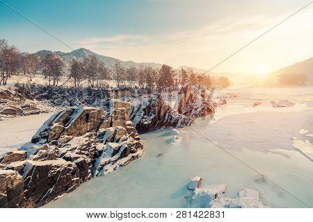 Winter Snow Frozen River In Mountains. Snow Winter Mountain River Valley Landscape. Winter Snow Froz