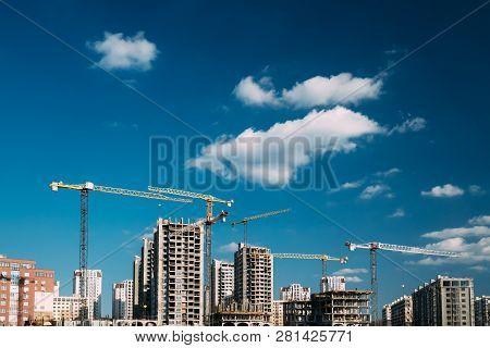 Construction Crane Is Involved In Development Of A New Multi-storey Residential Building.