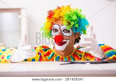 Male clown preparing for perfomance at home