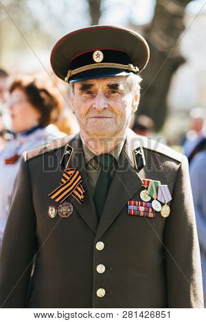 Vichuga, Russia - May 9, 2018: Portrait Of A Veteran In Uniform With Orders At Victory Parade In Hon