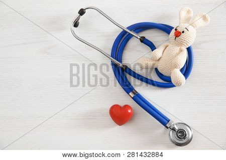 Toy Bunny, Stethoscope, Heart And Space For Text On White Wooden Background, Top View. Children's Do