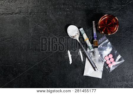 Money And Drugs. Syringe With Heroin. Scattered Pills. Copyspace.